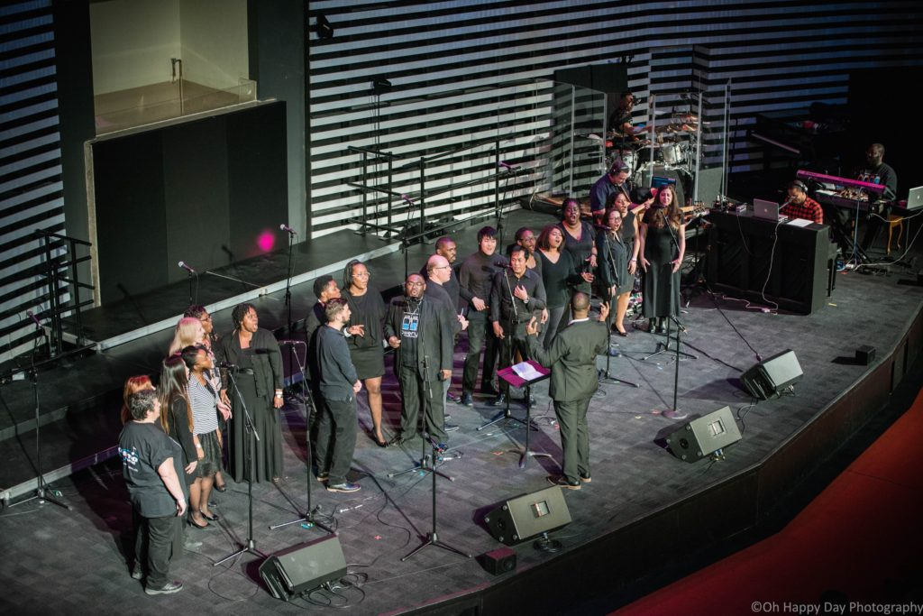 Darren Hamilton directing the 2018 PowerUp Chorale.