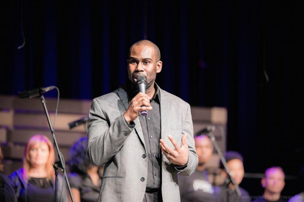 Darren Hamilton directing the 2017 PowerUp Chorale.